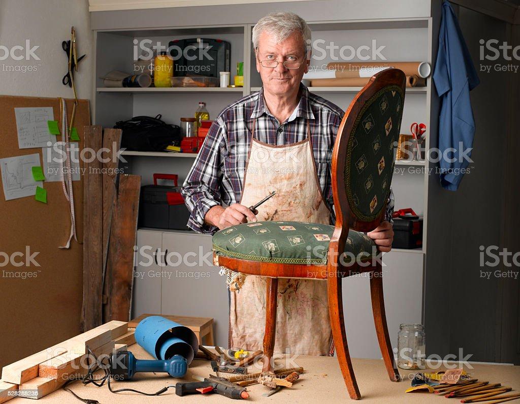 Retired man working stock photo