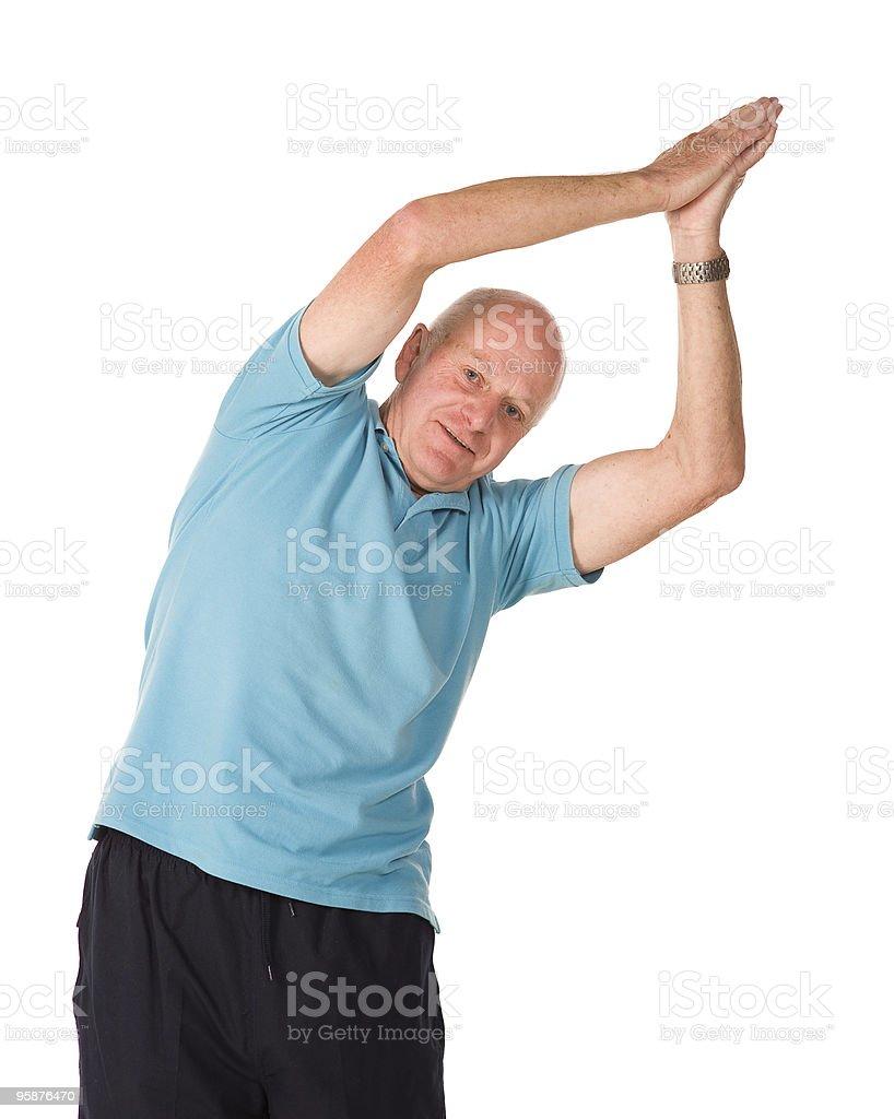 Retired older man doing yoga stock photo