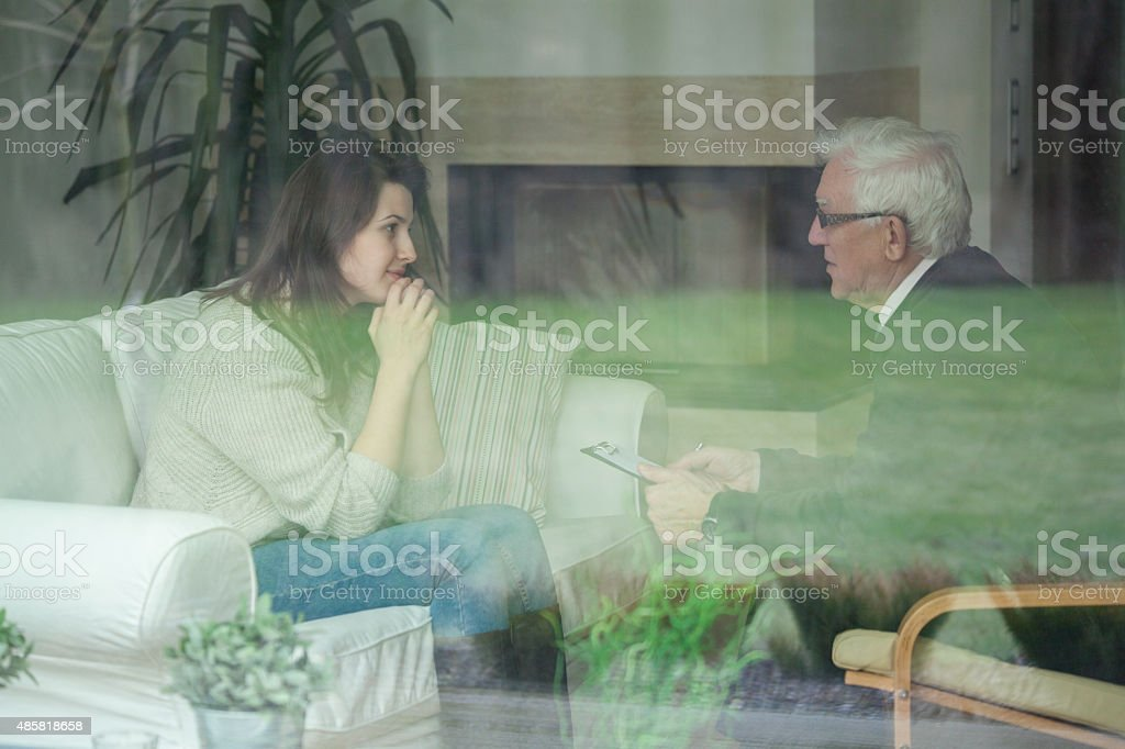 Retired psychologist consulting his patient stock photo