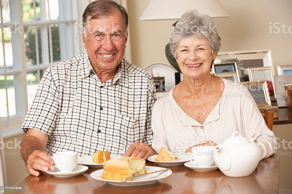 Retired Senior Couple Enjoying Afternoon Tea Together At Home royalty-free stock photo