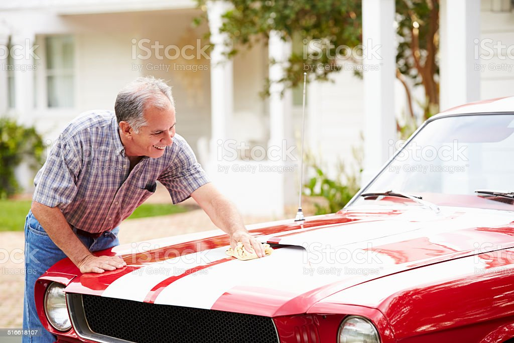 Retired Senior Man Cleaning Restored Car stock photo