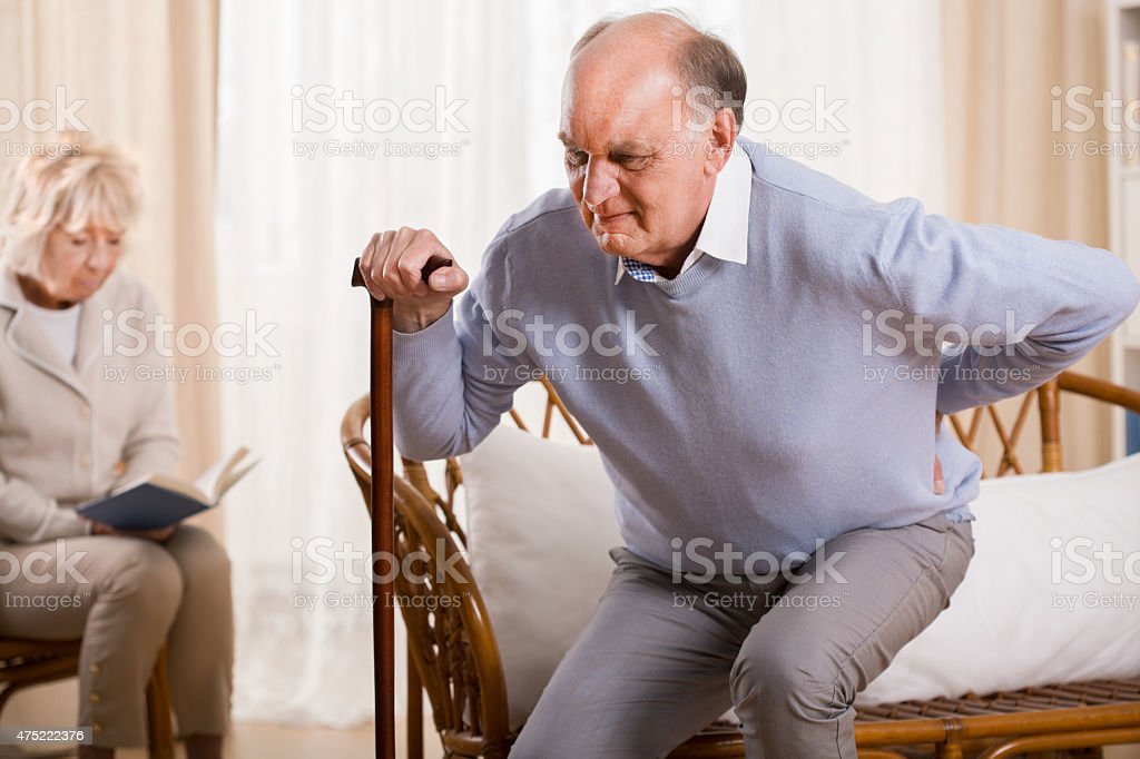 Retiree having backache stock photo