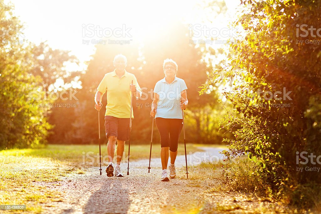 retirees nordic walking autum stock photo