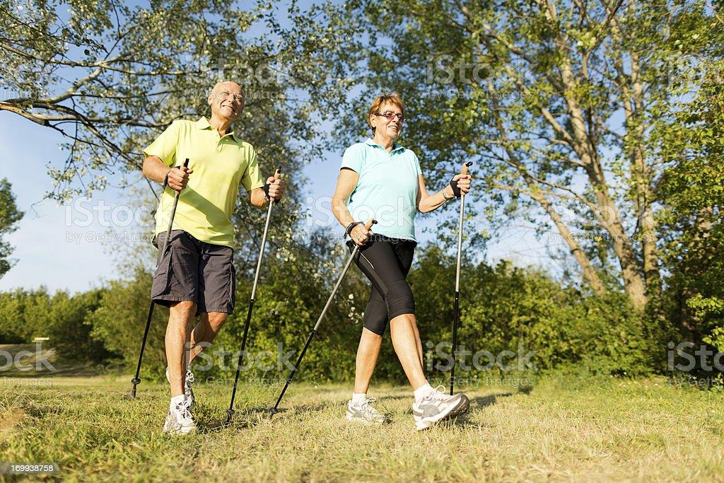 retirees nordic walking stock photo