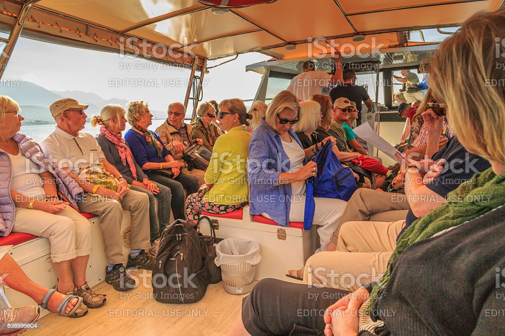 retirees on a boat trip on the bay stock photo