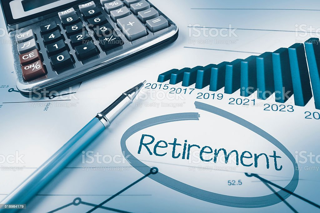 Retirement calculation, pen, calculator and graphs stock photo