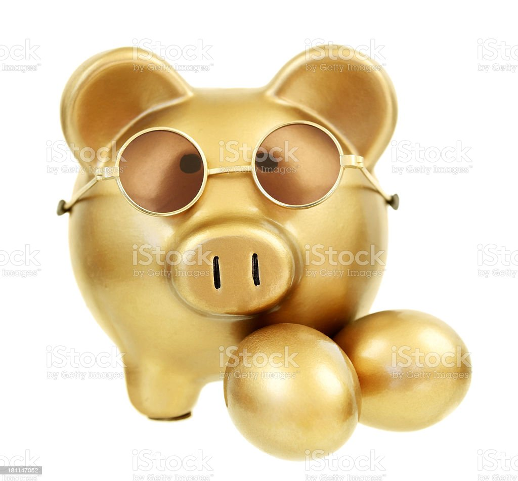 Retirement funds image of a gold piggy bank with gold eggs royalty-free stock photo