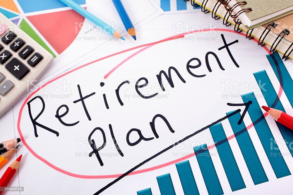 Retirement Plan circled in between charts and pens royalty-free stock photo