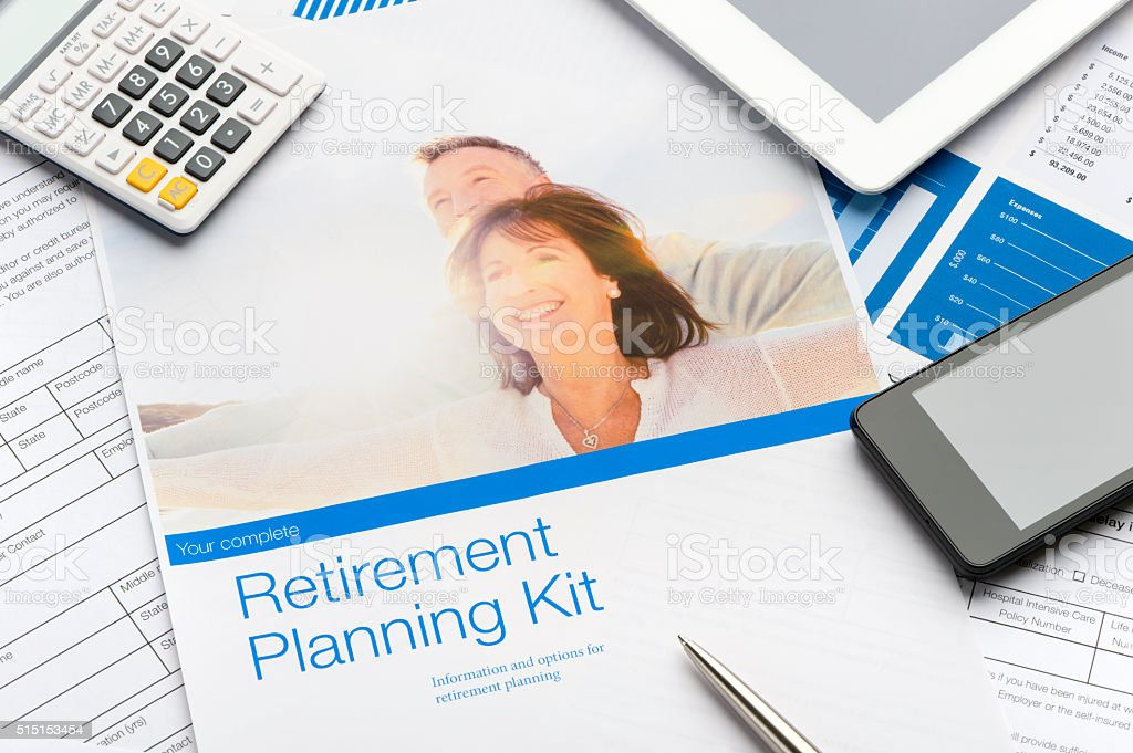 Retirement planning brochure with mature couple stock photo