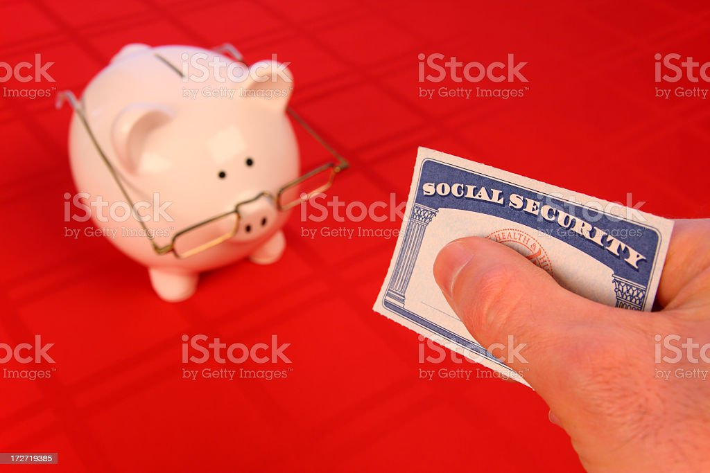 Retirement Savings in the Red: Social-Security Card and Spectacled Piggy-bank stock photo