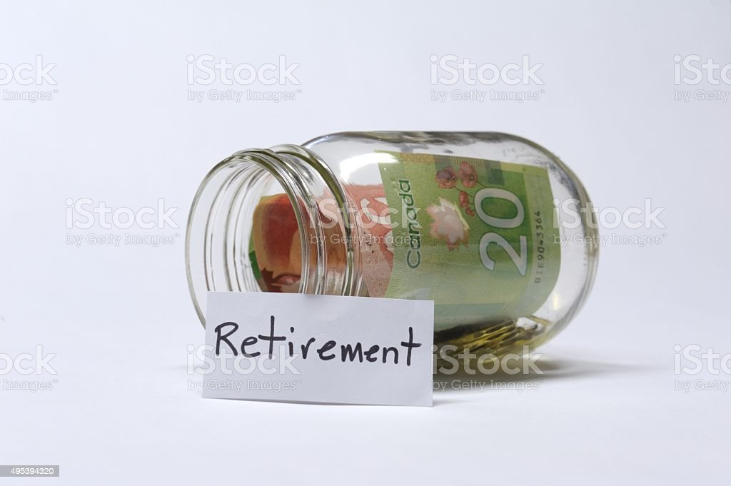 Retirement Savings Jar With Canadian Banknotes stock photo