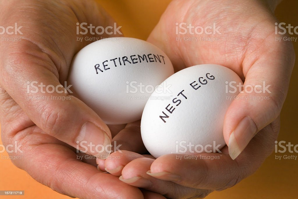 Retirement Savings Nest Egg Investments Securely Held in Woman's Hands royalty-free stock photo