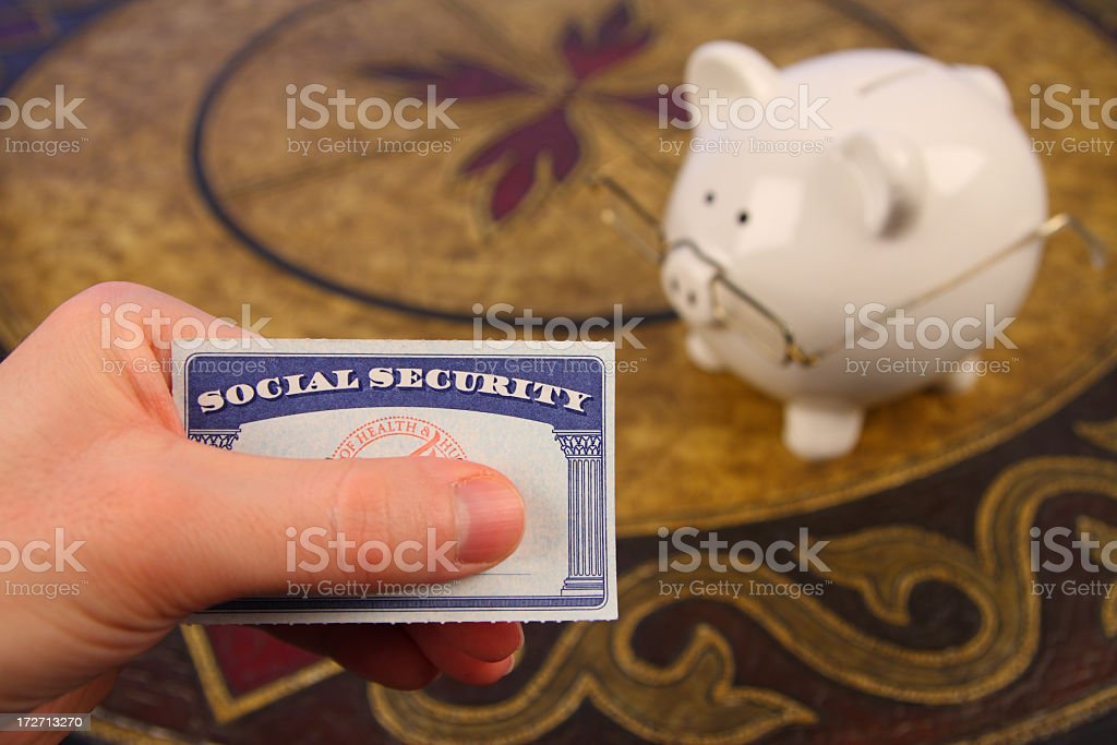 Retirement Savings: Social Security Card and Piggy Bank with Spectacles royalty-free stock photo