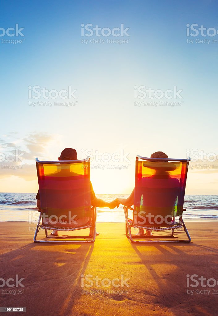 Retirement Vacation Concept, Mature Coupe Watching the Sunset stock photo