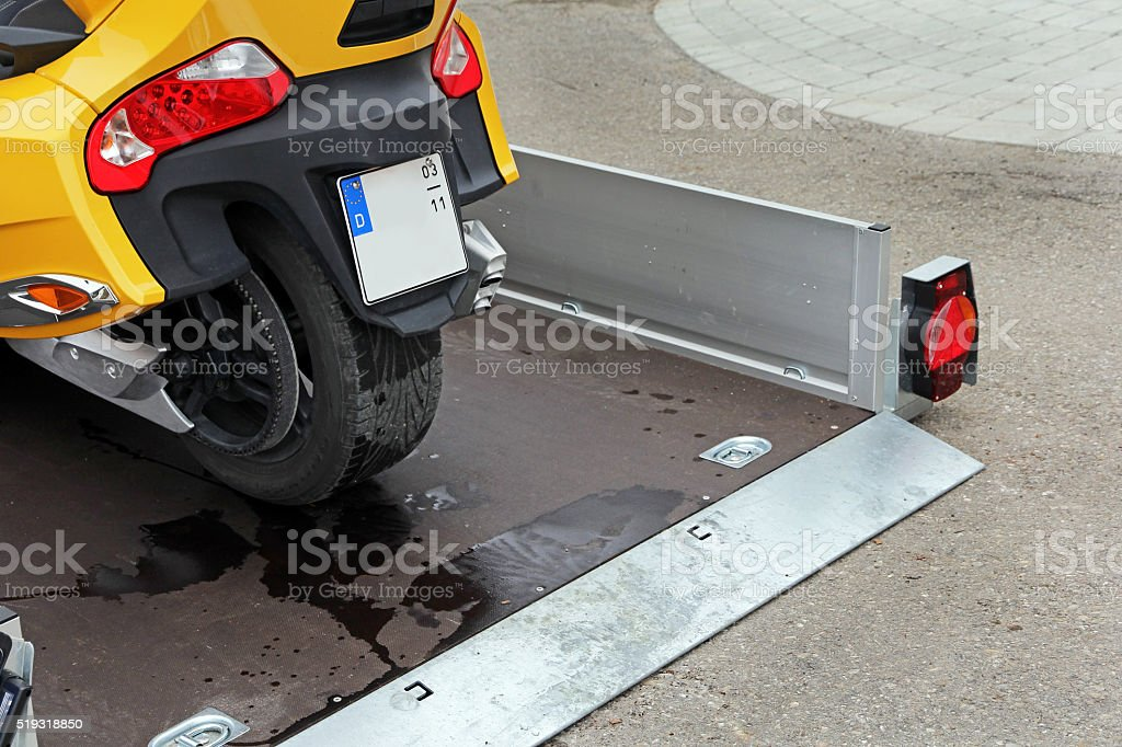 Retractable trailers for the transport of vehicles stock photo