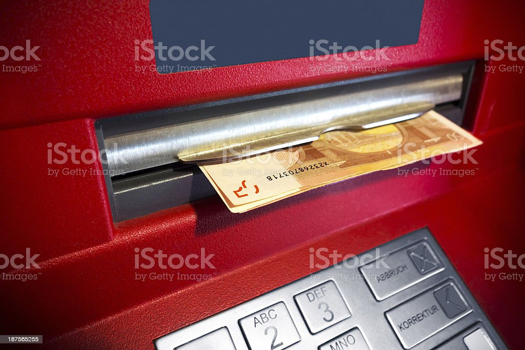 retrieving money from a red arm machine royalty-free stock photo