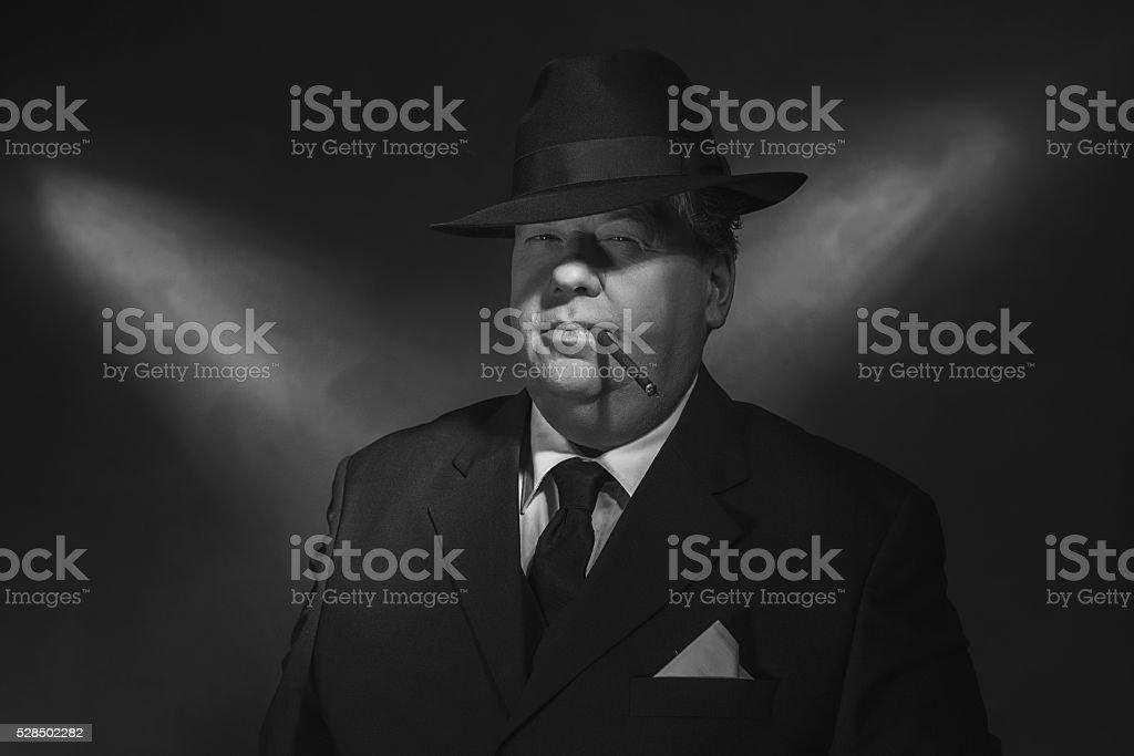 Retro 1930s gangster smoking cigar. Classic black and white portrait. stock photo