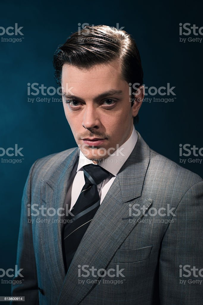 Retro 1940s business man in suit and tie. stock photo