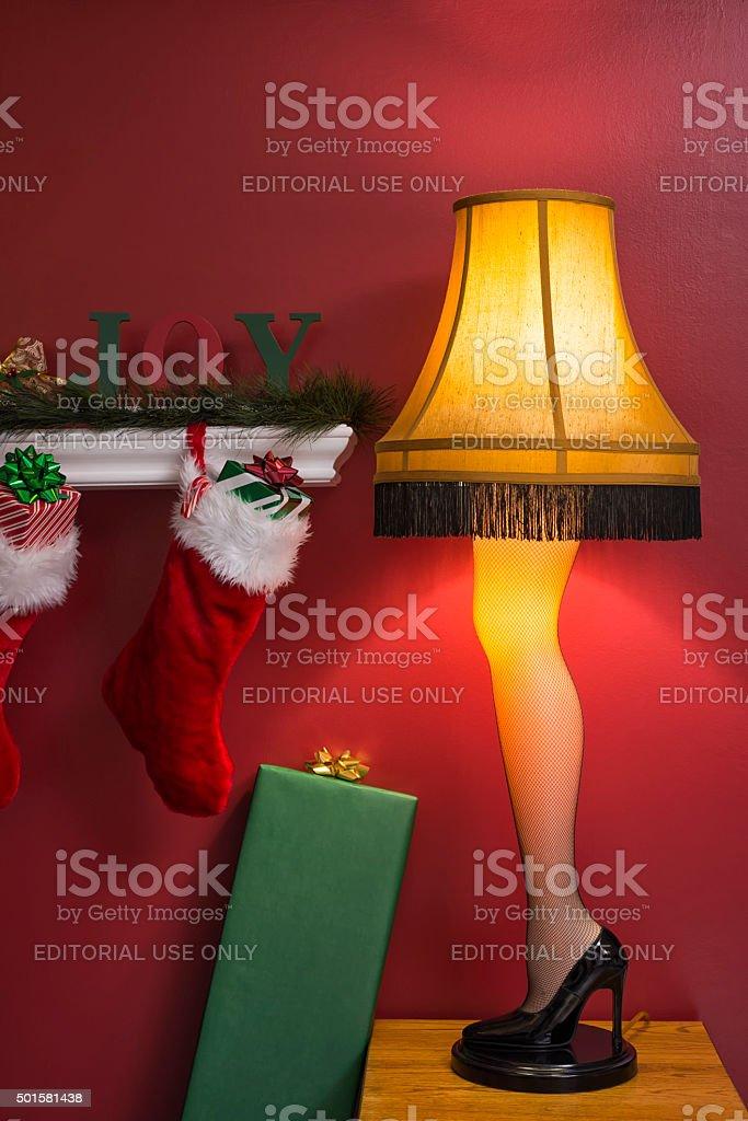Retro 1950's Leg Lamp next to Chirstmas Stockings stock photo