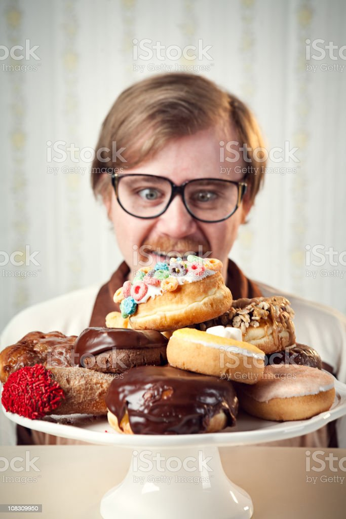 Retro 1970's Man with Donut Plate stock photo