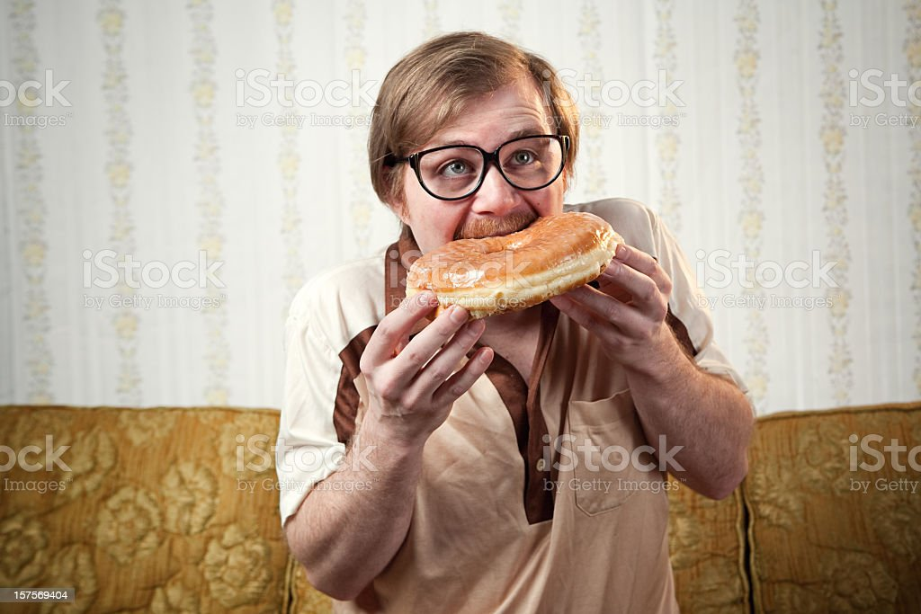 Retro 1970's Mustache Man with Huge Donut stock photo