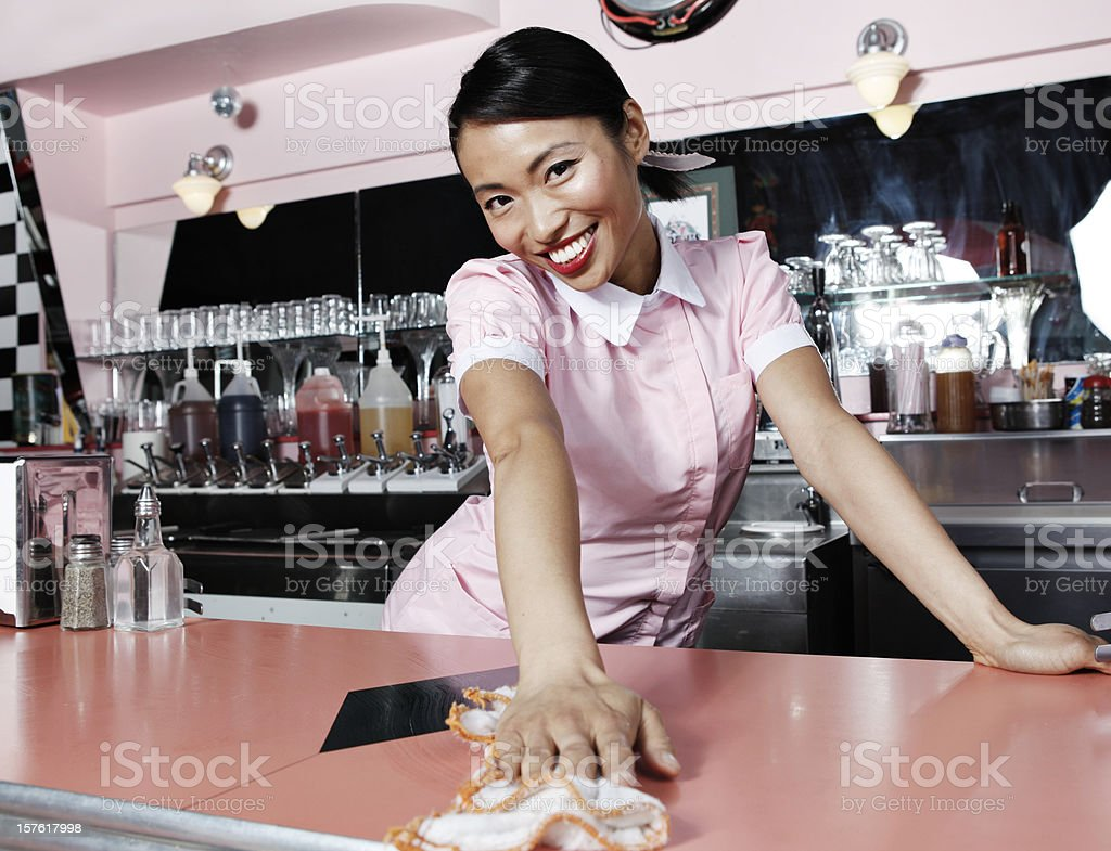 Retro 50's Waitress with Welcoming Smile royalty-free stock photo