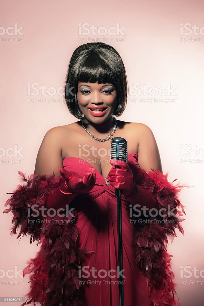 Retro 60s female african soul singer in red dress. stock photo
