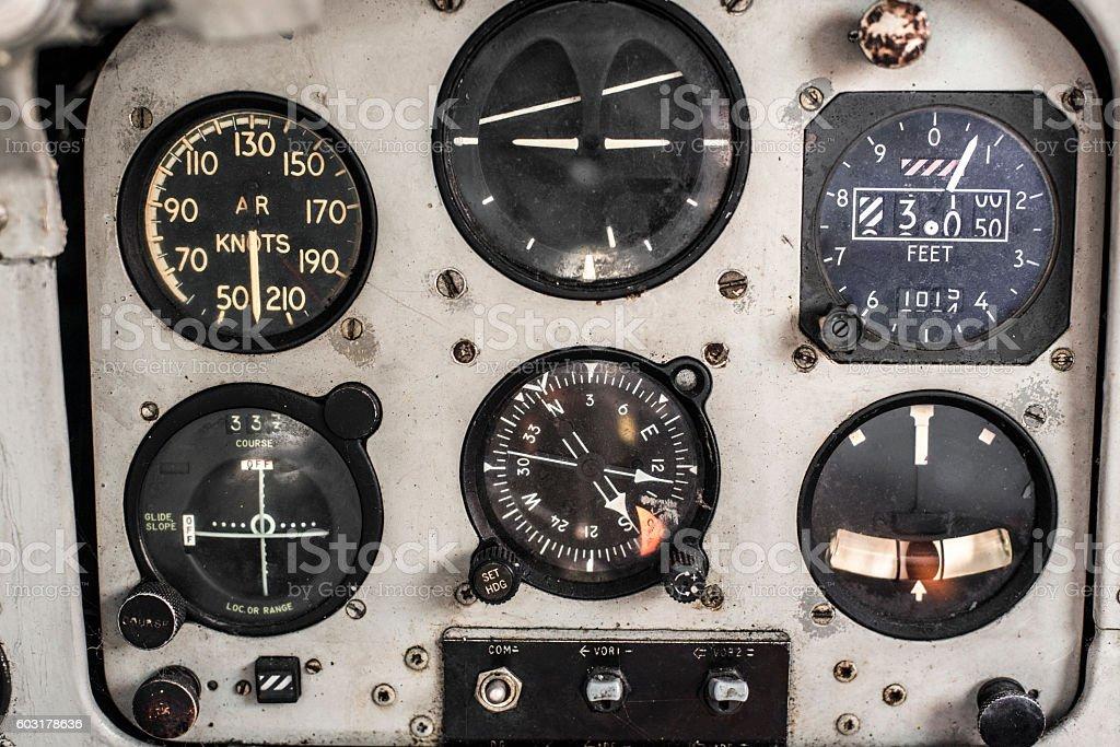 Retro 70's Aircraft cockpit dashboard control dials. stock photo