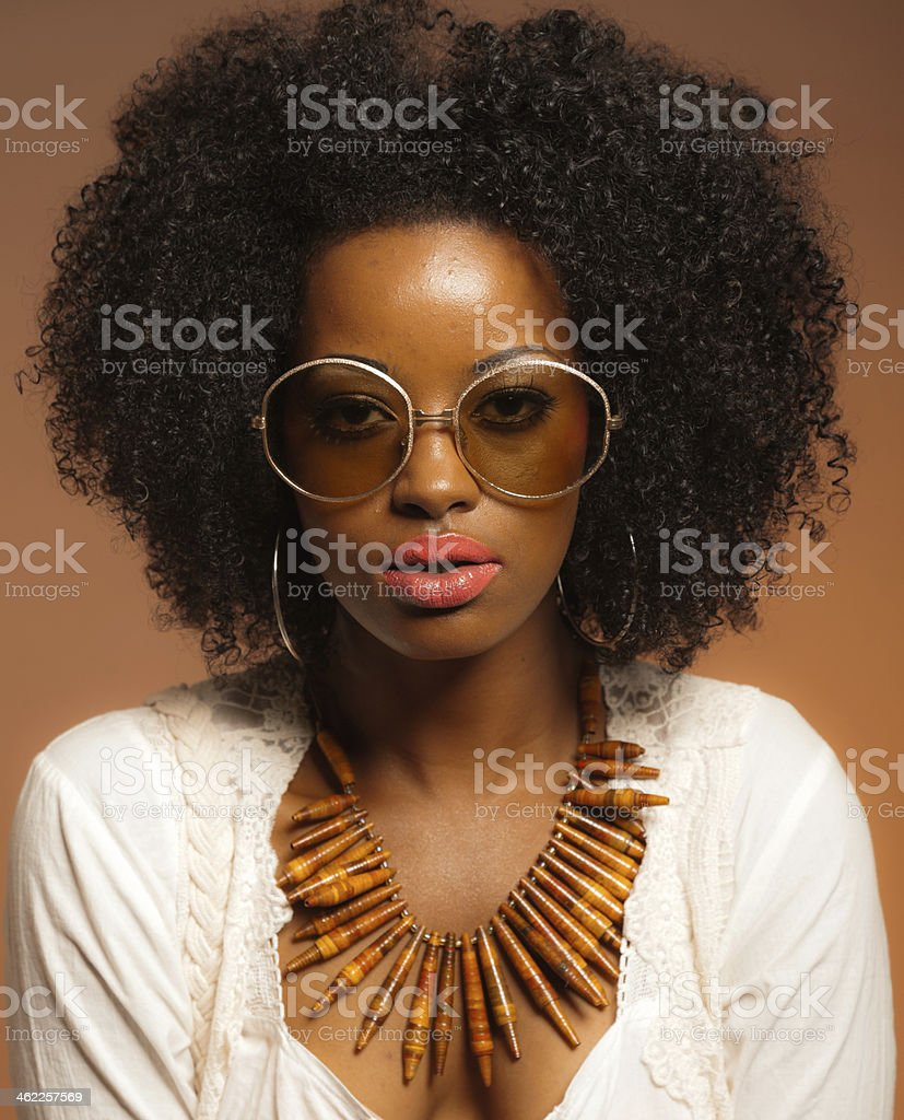 Retro 70s fashion black woman with sunglasses and white shirt. stock photo