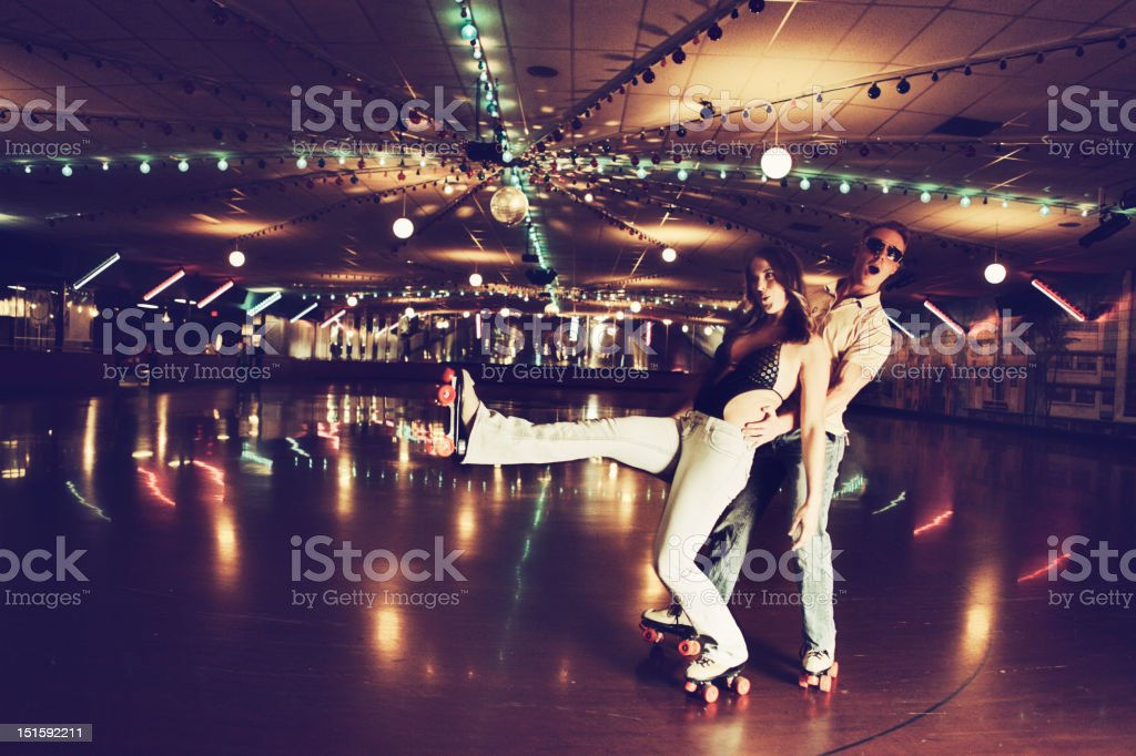Retro 70's Roller Disco Couple stock photo