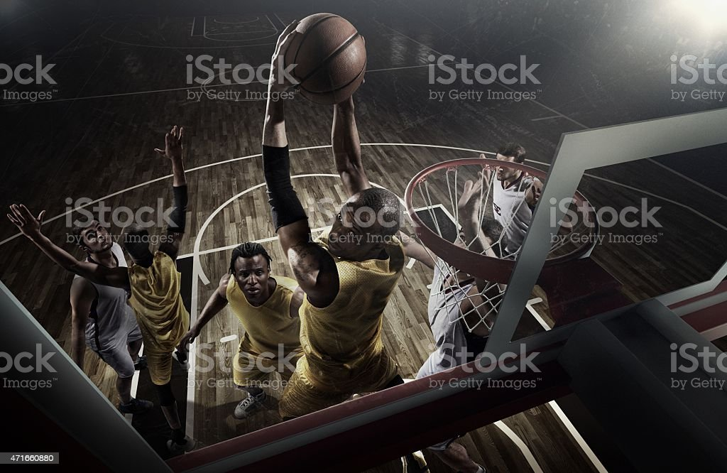 A retro action shot of an intense basketball game moment stock photo