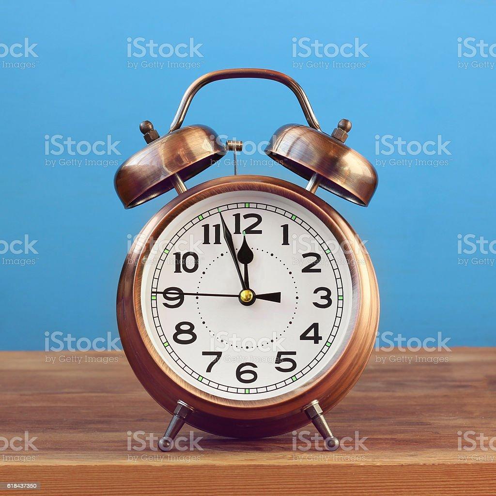 Retro alarm clock at twelve o'clock. stock photo
