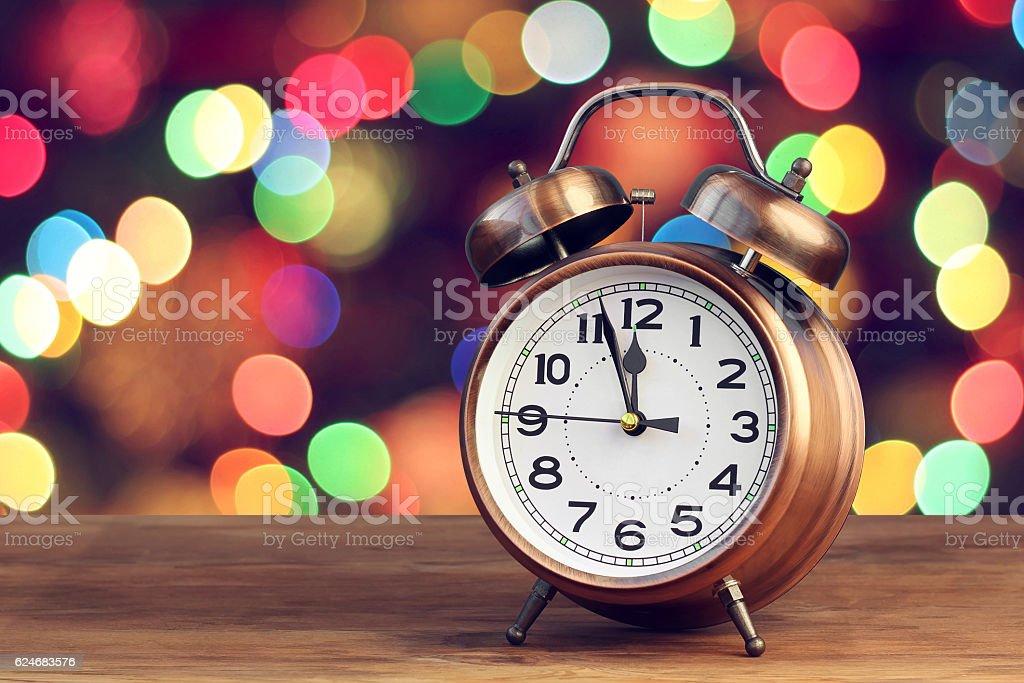 Retro alarm clock at twelve o'clock stock photo