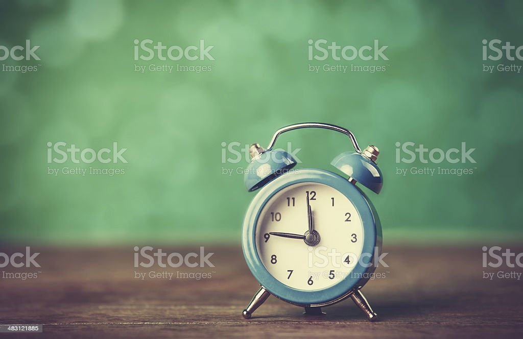 Retro alarm clock on a table stock photo