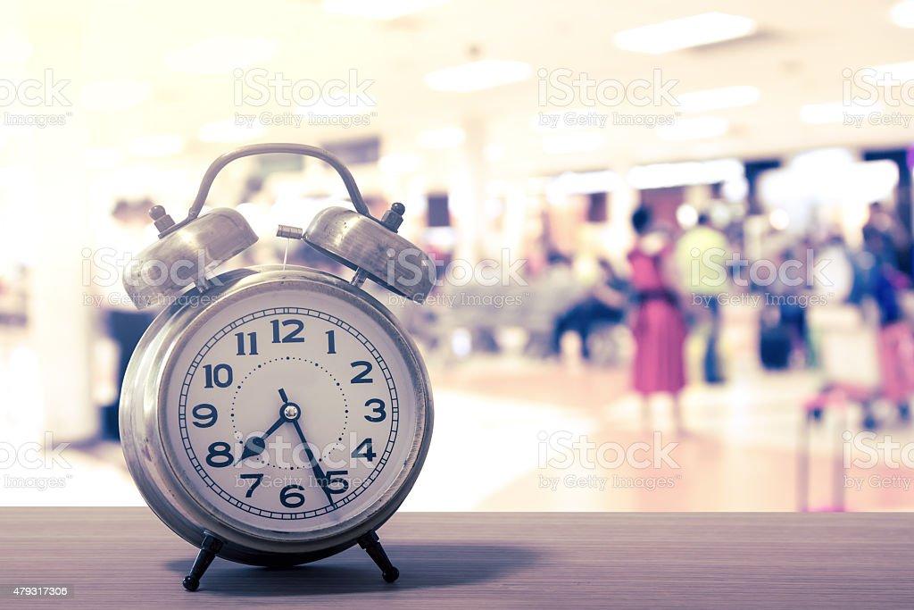 retro alarm clock on table stock photo