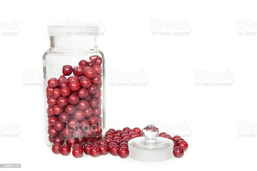 Retro aniseed ball sweets in a glass jar stock photo