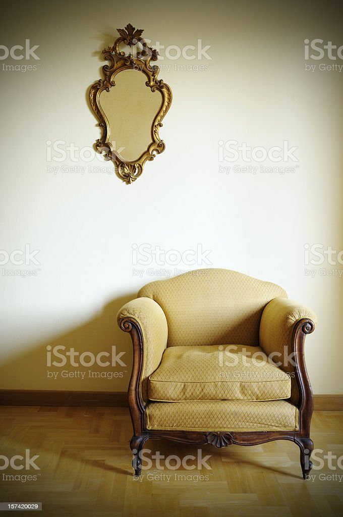 Retro Armchair with Gold Mirror royalty-free stock photo