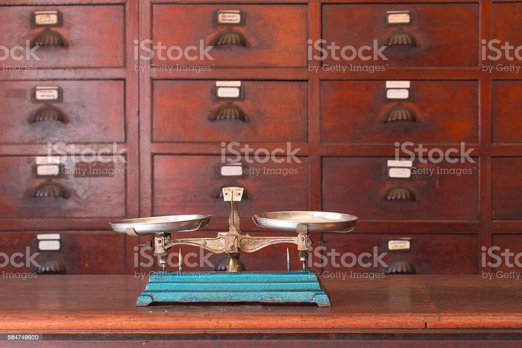 Retro Balance Scale at medicine shop. stock photo