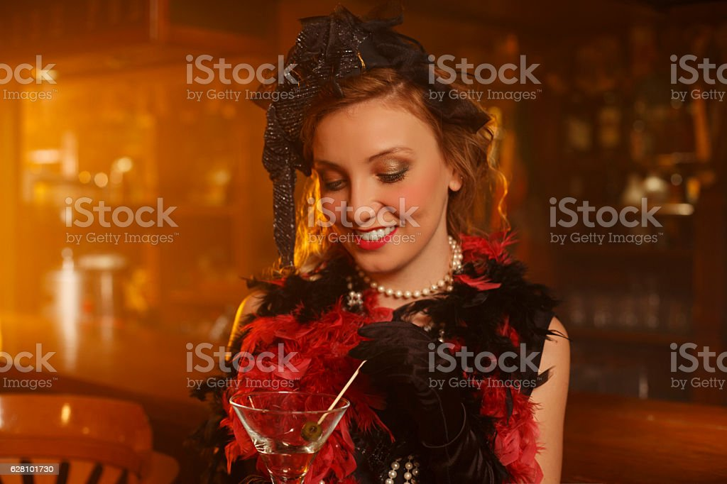 Retro bar  Old-fashioned  young woman drinking martini stock photo