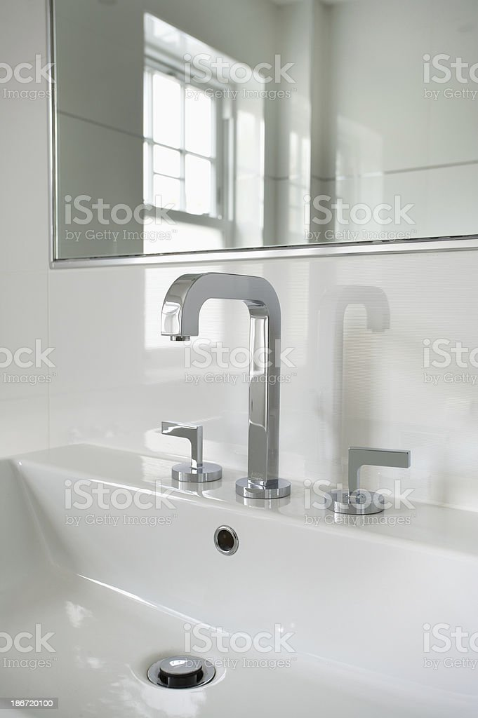 retro bathroom sink and taps stock photo