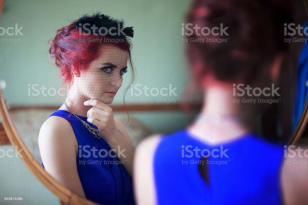 Retro Beautiful Young Woman looking in Mirror stock photo