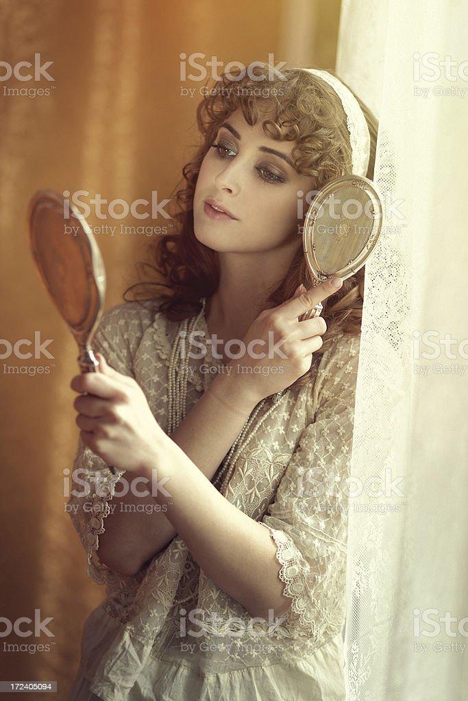 retro beauty combing her hair royalty-free stock photo