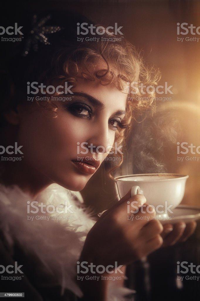 retro beauty drinking hot coffee stock photo