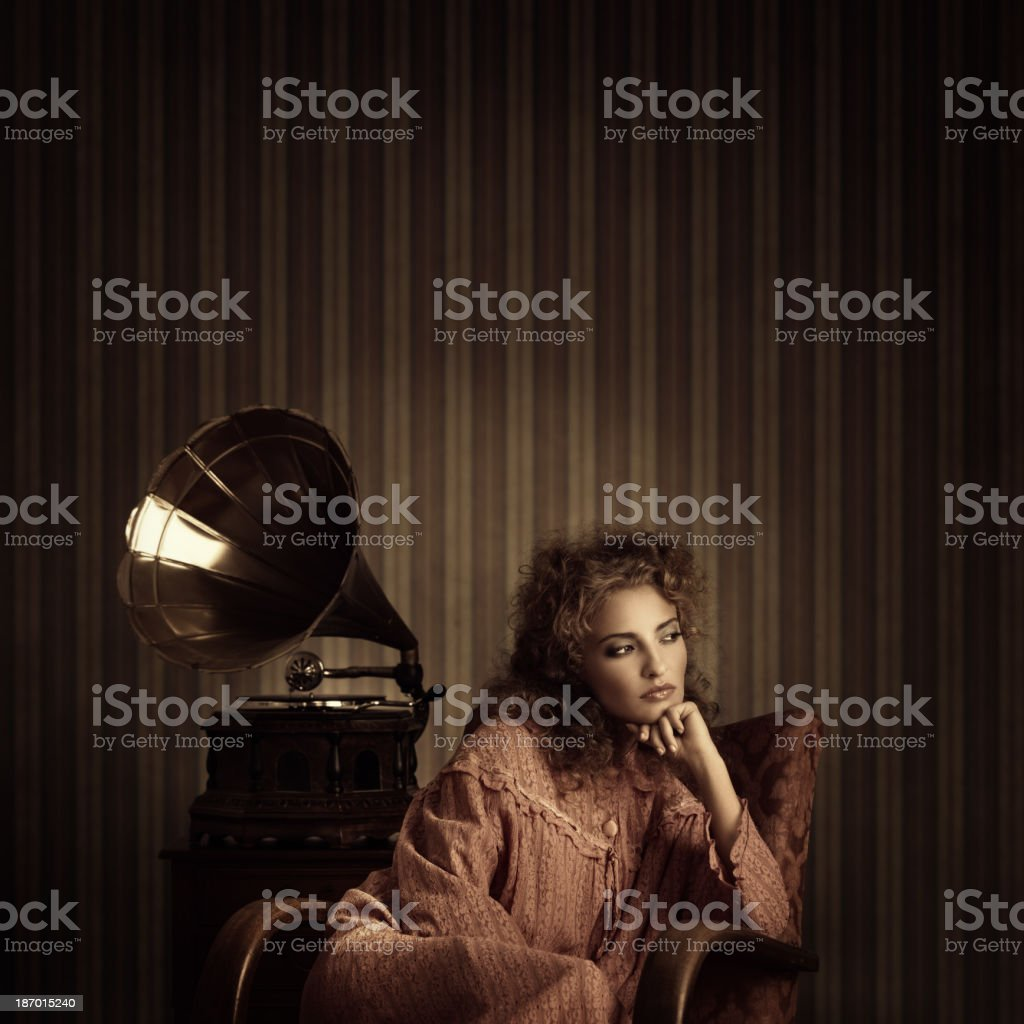 retro beauty listening to gramophone music stock photo