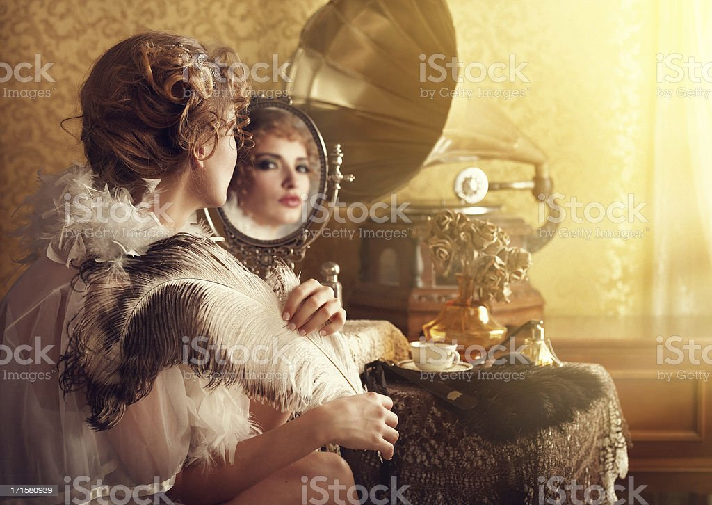 retro beuty with feather fan listening music in boudoir stock photo