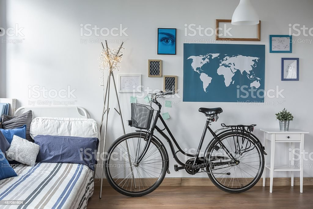 Retro bicycle in teen bedroom stock photo