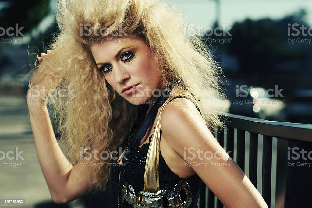 Retro Big Hair Blonde in Gold and Black Outfit stock photo