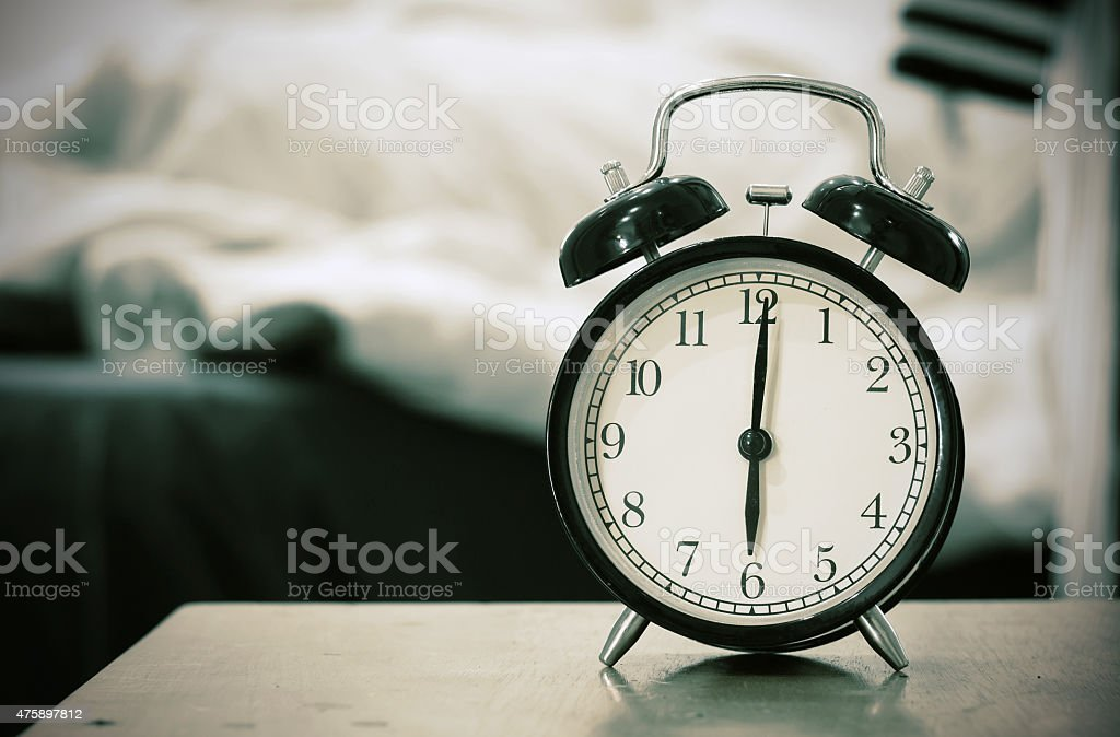 Retro black alarm clock stock photo