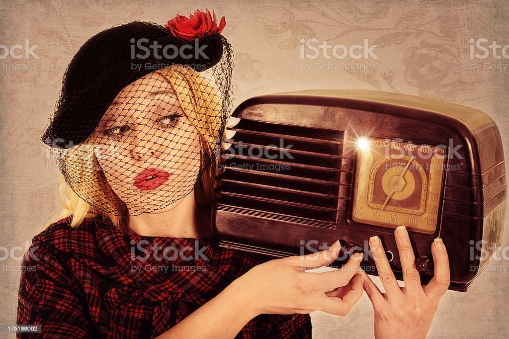 Retro Blond Tuning The Dial On Old Radio stock photo