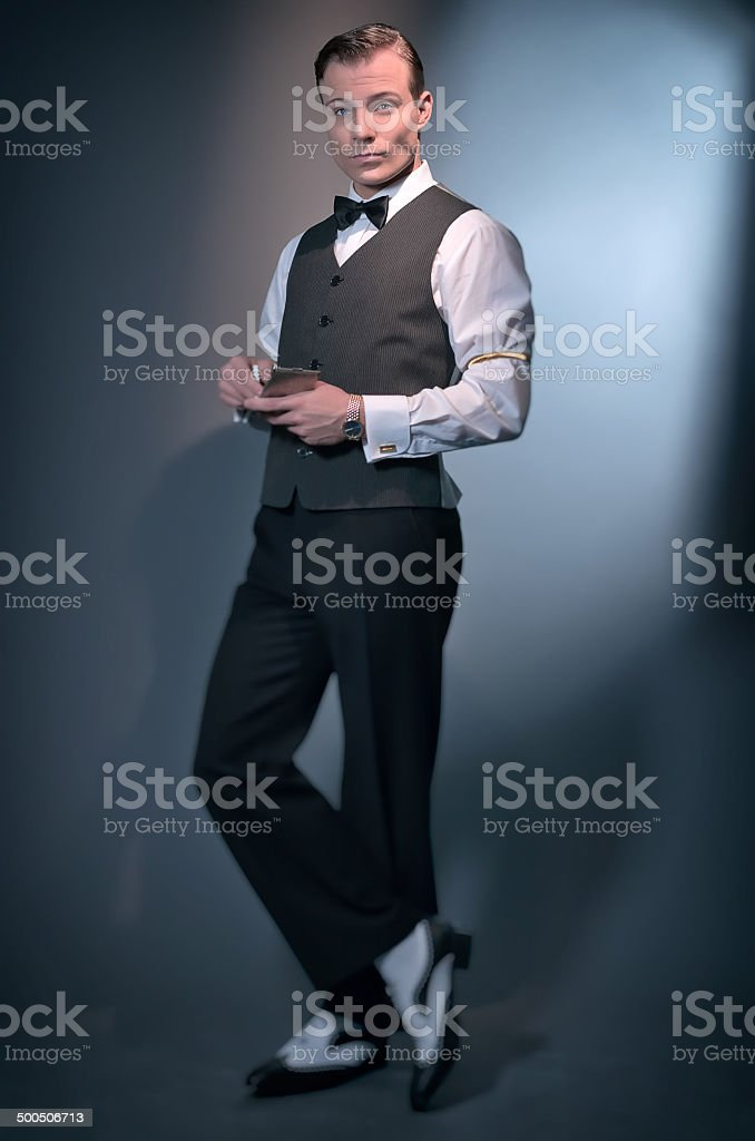 Retro business fashion man wearing grey gilet and bow tie. stock photo